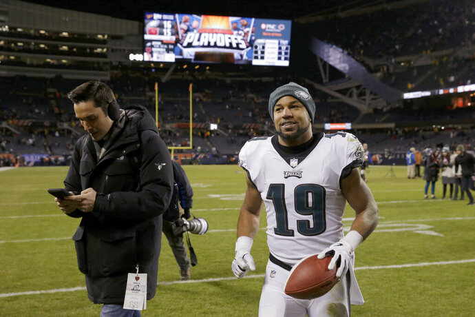 Philadelphia Eagles wide receiver Golden Tate (19) celebrates after an NFL wild-card playoff football game against the Chicago Bears Sunday, Jan. 6, 2019, in Chicago. The Eagles won 16-15. (AP Photo/David Banks)