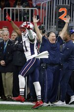 New England Patriots' Duron Harmon (21) and head coach Bill Belichick celebrate during the second half of the NFL Super Bowl 53 football game against the Los Angeles Rams Sunday, Feb. 3, 2019, in Atlanta. The Patriots won 13-2. (AP Photo/Patrick Semansky)