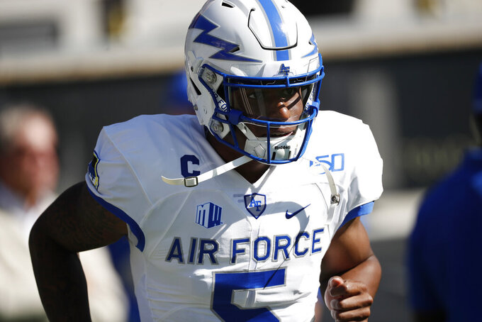 Air Force quarterback Donald Hammond III warms up before an NCAA college football game against Colorado, Saturday, Sept. 14, 2019, in Boulder, Colo. (AP Photo/David Zalubowski)