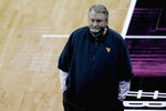West Virginia head coach Bob Huggins watches during the second half of an NCAA college basketball game against Oklahoma State in the second round of the Big 12 men's tournament in Kansas City, Mo., Thursday, March 11, 2021. Oklahoma State won 72-69. (AP Photo/Charlie Riedel)