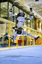 A Boston Dynamics Atlas robot performs a jump during a demonstration, Wednesday, Jan. 13, 2021, at the company's facilities in Waltham, Mass. The company engineered the robot to be able to dance in a fluid manner that is almost human. (AP Photo/Josh Reynolds)