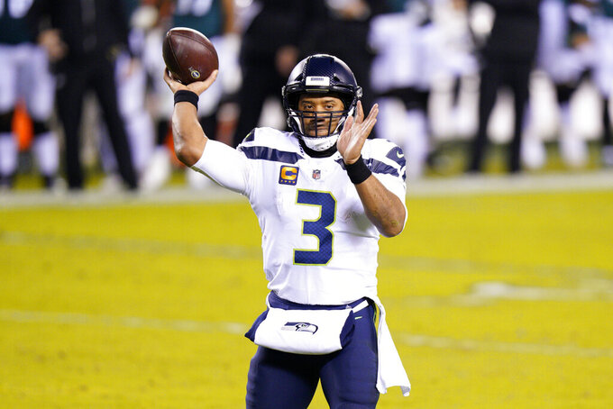 Seattle Seahawks' Russell Wilson passes during the first half of an NFL football game against the Philadelphia Eagles, Monday, Nov. 30, 2020, in Philadelphia. (AP Photo/Chris Szagola)