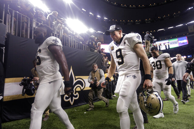 New Orleans Saints quarterback Drew Brees (9) walks off the field after their overtime loss to the Minnesota Vikings in an NFL wild-card playoff football game, Sunday, Jan. 5, 2020, in New Orleans. The Vikings won 26-20. (AP Photo/Brett Duke)