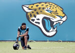 Jacksonville Jaguars wide receiver Rashad Greene takes a break during an NFL football practice Wednesday, June 13, 2018, in Jacksonville, Fla. (AP Photo/John Raoux)