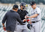 Chicago White Sox relief pitcher Jace Fry is pulled by manager Tony La Russa, with catcher Yasmani Grandal looking on, during the seventh inning of a baseball game against the Detroit Tigers, Tuesday, Sept. 21, 2021, in Detroit. The Tigers defeated the White Sox 5-3. (AP Photo/Duane Burleson)