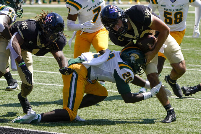 Wake Forest quarterback Sam Hartman scores pass Norfolk State defensive back R.J. Coles during the first half of a NCAA college football game Saturday, Sept. 11, 2021, in Winston-Salem, N.C. (AP Photo/Chris Carlson)