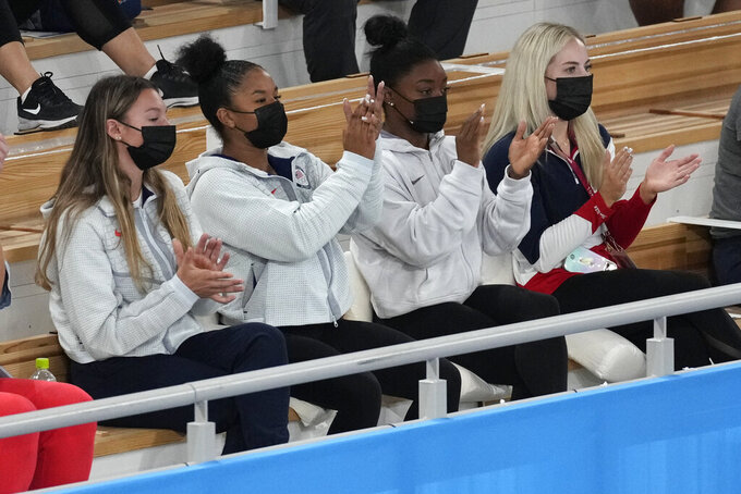 From left, United States' gymnast Grace McCallum, Jordan Chiles, Simone Biles and MyKayla Skinner celebrate after teammate Sunisa Lee won the gold medal for the artistic gymnastics women's all-around final at the 2020 Summer Olympics, Thursday, July 29, 2021, in Tokyo. (AP Photo/Ashley Landis)