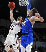 Mississippi State guard Quinndary Weatherspoon (11) shoots a hook shot over Brigham Young forward Gavin Baxter (25) in the first half of an NCAA college basketball game in Starkville, Miss., Saturday, Dec. 29, 2018. (AP Photo/Rogelio V. Solis)
