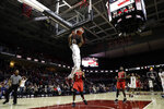 Temple's Quinton Rose (1) dunks the ball past Houston's Nate Hinton (11) during the final minutes of an NCAA college basketball game, Wednesday, Jan. 9, 2019, in Philadelphia. Temple won 73-69. (AP Photo/Matt Slocum)