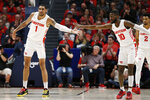 Dayton forward Obi Toppin (1) is congratulated for his 3-point basket against Davidson by guard Jalen Crutcher (10) during the first half of an NCAA college basketball game Friday, Feb. 28, 2020, in Dayton, Ohio. (AP Photo/Gary Landers)
