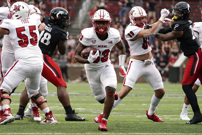 Miami (Ohio) running back Kenny Tracy (33) scores a touchdown during the second half of an NCAA college football game against Cincinnati, Saturday, Sept. 4, 2021, in Cincinnati. (AP Photo/Jeff Dean)