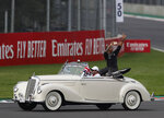 Mercedes driver Lewis Hamilton, of Britain, flashes a victory sign during the opening parade of the Formula One Mexico Grand Prix auto race at the Hermanos Rodriguez racetrack in Mexico City, Sunday, Oct. 27, 2019. (AP Photo/Eduardo Verdugo)