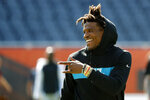 Carolina Panthers quarterback Cam Newton smiles and points at a teammates before an NFL preseason football game against the Chicago Bears Thursday, Aug. 8, 2019, in Chicago. (AP Photo/Charles Rex Arbogast)