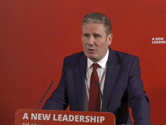 """In this image taken from video issued by Britain's Labour Party showing Labour Party leader Keir Starmer as he makes a statement accepting all recommendations of a damning anti-Semitism report by the Equality and Human Rights Commission (EHRC), in London Thursday Oct. 29, 2020.  Former party leader Jeremy Corbyn has been suspended by the party Thursday. The report says the opposition Labour Party failed to stamp out anti-Semitism and committed """"unlawful acts of harassment and discrimination"""" against members of the Jewish community. (Labour Party via AP)"""