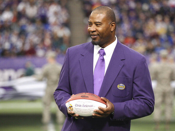 FILE - In this Dec. 15, 2013, file photo, former Minnesota Viking Chris Doleman acknowledges the crowd during a ceremony honoring the All Mall of America Field team during halftime of an NFL football game between the Vikings and the Philadelphia Eagles in Minneapolis. Hall of Fame defensive end Doleman, who became one of the NFL's most feared pass rushers during 15 seasons in the league, has died. He was 58. The Vikings and Pro Football Hall of Fame president and CEO David Baker offered their condolences in separate statements late Tuesday night, Jan. 29, 2020. (AP Photo/Andy King, File)