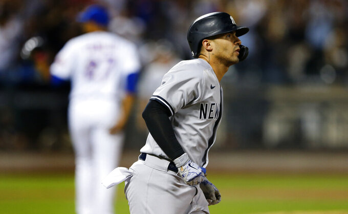 New York Yankees' Gleyber Torres rounds the base after hitting a two-run home run against New York Mets' Jeurys Familia during the sixth inning of a baseball game on Sunday, Sept. 12, 2021, in New York. (AP Photo/Noah K. Murray)