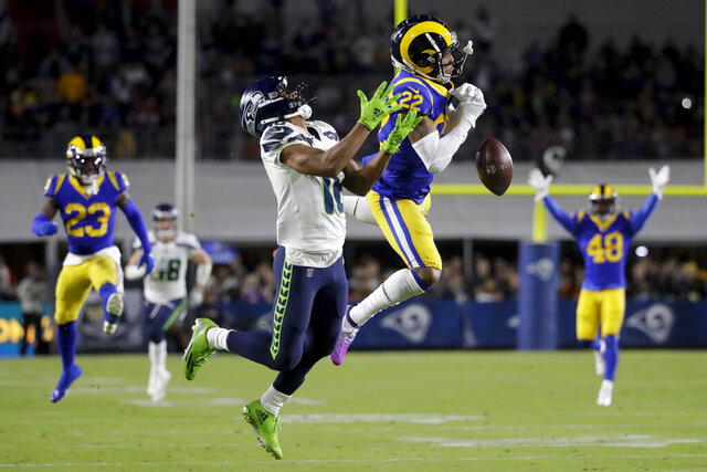 Los Angeles Rams cornerback Troy Hill breaks up a pass intended for Seattle Seahawks wide receiver Tyler Lockett during the first half of an NFL football game Sunday, Dec. 8, 2019, in Los Angeles. (AP Photo/Marcio Jose Sanchez)