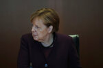 German Chancellor Angela Merkel attends the weekly cabinet meeting of the German government at the chancellery in Berlin, Wednesday, Jan. 29, 2020. (AP Photo/Markus Schreiber)