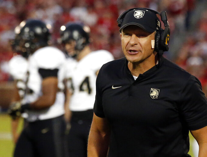 FILE- In this Sept. 22, 2018, file photo, Army coach Jeff Monken shouts during the first half of the team's NCAA college football game against Oklahoma in Norman, Okla. Under Monken's leadership, the Black Knights had an academy-record 11 wins last season and a final ranking of No. 19 in the AP Top 25. (AP Photo/Sue Ogrocki, File)