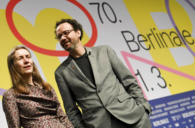 The directors of the Berlinale film festival Carlo Chatrian and Mariette Rissenbeek present the program of the Berlinale in Berlin, Germany, Wednesday, Jan.29, 2020. The 70th International Film Festival begins on Feb.20.  (Britta Pedersen/dpa via AP)