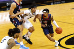 Liberty's Chris Parker, right, dribbles around Missouri's Drew Buggs, middle, during the first half of an NCAA college basketball game Wednesday, Dec. 9, 2020, in Columbia, Mo. (AP Photo/L.G. Patterson)