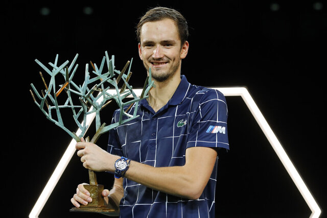 Russia's Daniil Medvedev holds his trophy after the Paris Masters tennis tournament final, Sunday, Nov. 8, 2020 in Paris. Daniil Medvedev won the Paris Masters for the first time by beating Germany's Alexander Zverev 5-7, 6-4, 6-1 on Sunday for his eighth career title and third at a Masters event. (AP Photo/Christophe Ena)