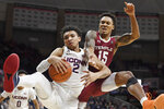 Connecticut's James Bouknight (2) pulls down a rebound over Temple's Nate Pierre-Louis (15) in the second half of an NCAA college basketball game, Wednesday, Jan. 29, 2020, in Storrs, Conn. (AP Photo/Jessica Hill)