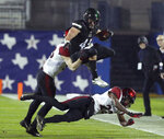 Ohio running back A.J. Ouellette (45) leaps over San Diego State cornerback Darren Hall (23) in the first half of the Frisco Bowl NCAA college football game, Wednesday, Dec. 19, 2018, in Frisco, Texas. (AP Photo/Richard W. Rodriguez)