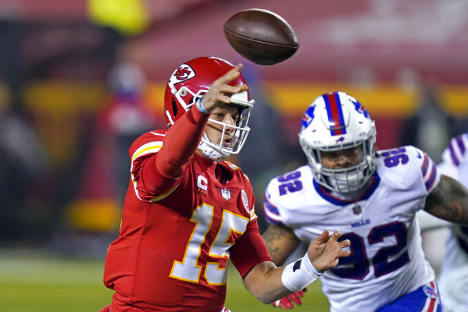 Kansas City Chiefs quarterback Patrick Mahomes (15) throws a pass ahead of Buffalo Bills defensive end Darryl Johnson, right, during the first half of the AFC championship NFL football game, Sunday, Jan. 24, 2021, in Kansas City, Mo. (AP Photo/Orlin Wagner)