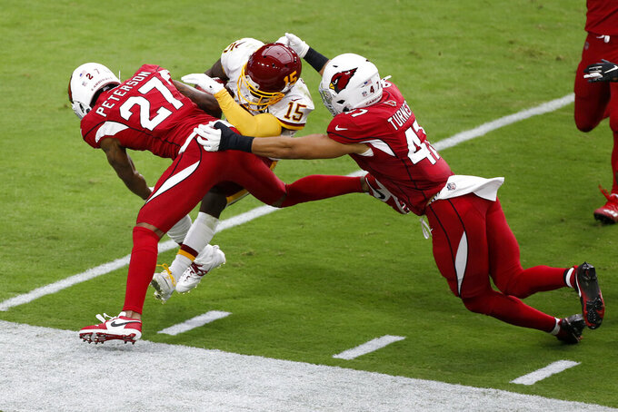 Arizona Cardinals cornerback Kevin Peterson (27) hits Washington Football Team wide receiver Steven Sims (15) during the first half of an NFL football game, Sunday, Sept. 20, 2020, in Glendale, Ariz. (AP Photo/Darryl Webb)