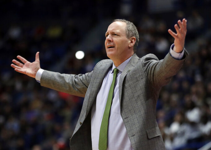 Vermont head coach John Becker gestures during the first half of a first round men's college basketball game against Florida State in the NCAA Tournament, Thursday, March 21, 2019, in Hartford, Conn. (AP Photo/Elise Amendola)