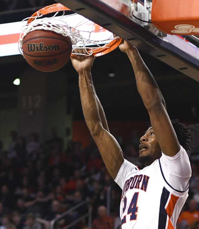 Auburn forward Anfernee McLemore (24) dunks against North Florida during the first half of an NCAA college basketball game Saturday, Dec. 29, 2018, in Auburn, Ala. (AP Photo/Julie Bennett)