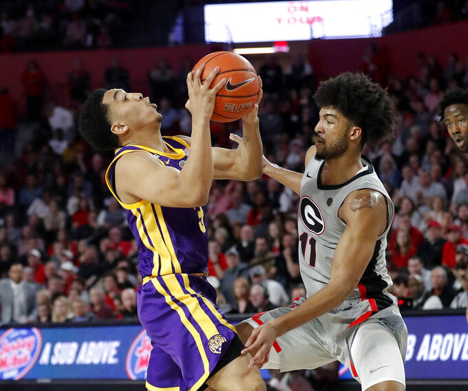 LSU guard Tremont Waters (3) drives against Georgia guard Christian Harrison (11) during the second half of an NCAA college basketball game Saturday, Feb. 16, 2019, in Athens, Ga. (AP Photo/John Bazemore)