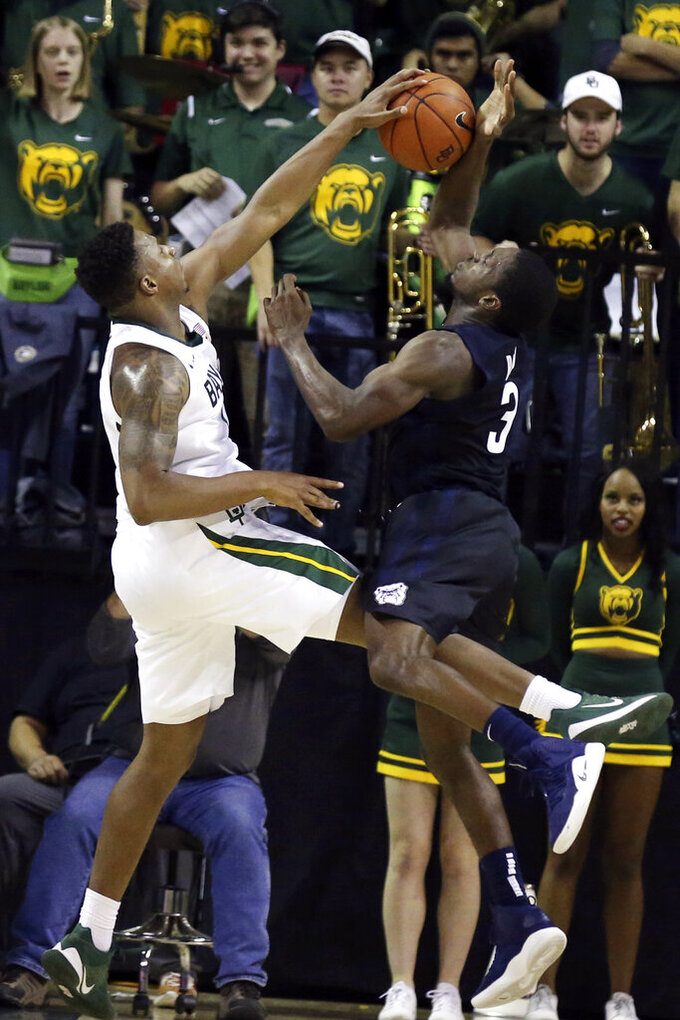 Baylor guard Mark Vital, left, blocks the shot of Butler guard Kamar Baldwin, right, late in the second half of an NCAA college basketball game, Tuesday, Dec. 10, 2019, in Waco, Texas. (AP Photo/Rod Aydelotte)