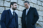 """This image released by AMC+ shows Charlie Cox, left, and Ciarán Hinds in a scene from """"Kin,"""" premiering on Sept. 9. (Patrick Redmond/AMC+ via AP)"""