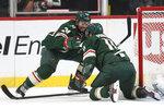 Minnesota Wild's Matt Dumba (24) celebrates teammate Zach Parise's (11) goal in the second period of an NHL hockey game against the Carolina Hurricanes, Saturday, Nov. 16, 2019, in St. Paul, Minn. (AP Photo/Stacy Bengs)