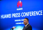 Song Liuping, chief legal officer of Huawei, speaks during a press conference at Huawei's campus in Shenzhen in southern China's Guandong Province, Thursday, Dec. 5, 2019. Chinese tech giant Huawei is asking a U.S. federal court to throw out a rule that bars rural phone carriers from using government money to purchase its equipment on security grounds. (AP Photo/Mark Schiefelbein)