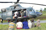 Soldiers and paramedics carry injured survivors from a helicopter in Chimanimani about 600 kilometres south east of Harare, Zimbabwe, Tuesday, March, 19, 2019.  According to the government, Cyclone Idai has killed more than 100 people in Chipinge and Chimanimani and according to residents the figures could be higher because the hardest hit areas are still inaccessible.  Some hundreds are dead, many more are missing, and some thousands at risk from the massive flooding throughout the region of Mozambique, Malawi and Zimbabwe caused by Cyclone Idai.(AP Photo/Tsvangirayi Mukwazhi)