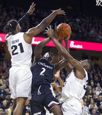 Cincinnati guard Keith Williams (2) fights for control of the ball with Central Florida forward Chad Brown (21) and forward Collin Smith (35) during the first half of an NCAA college basketball game, Thursday, March 7, 2019, in Orlando, Fla. (AP Photo/Willie J. Allen Jr.)