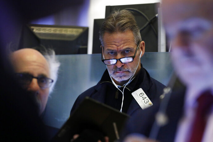 Trader Ronald Madarasz works on the floor of the New York Stock Exchange, Friday, Feb. 14, 2020. U.S. stocks wobbled between small gains and losses in early trading Friday as investors focused on another round of mostly solid corporate earnings. (AP Photo/Richard Drew)