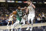 Boston Celtics guard Marcus Smart (36) drives around Indiana Pacers forward Domantas Sabonis (11) during the second half of an NBA basketball game in Indianapolis, Tuesday, March 10, 2020. The Celtics won 114-111. (AP Photo/AJ Mast)
