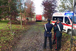 Carabinieri officers stand at the entrance of a farm following an explosion in a building in Quargnento, Northern Italy, Tuesday, Nov. 5, 2019. Sky TG24 reported that firefighters were responding to a report of an explosion in a disused section of a farm building in Alessandria province when a second, stronger explosion occurred early Tuesday, killing three firefighters. (Dino Ferretti/ANSA via AP)