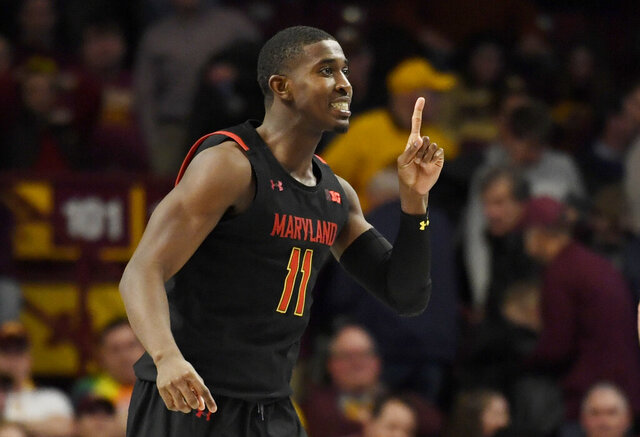 Maryland's Darryl Morsell celebrates his go-ahead 3-point basket against Minnesota late in the second half of an NCAA college basketball game Wednesday, Feb. 26, 2020, in Minneapolis. Maryland won 74-73. (AP Photo/Hannah Foslien)