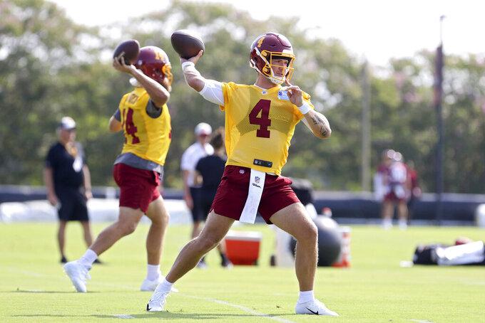 Washington Football Team quarterback Taylor Heinicke (4) throws a pass during NFL football practice in Richmond, Va., Wednesday, July 28, 2021. (AP Photo/Ryan M. Kelly)