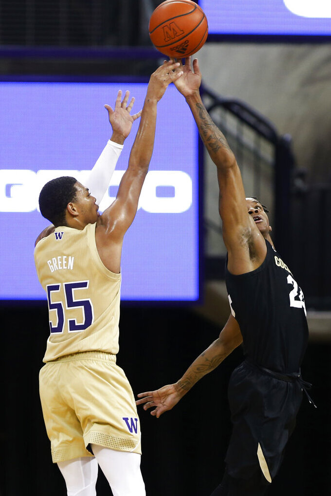 Colorado's Eli Parquet (24) blocks a shot by Washington's Quade Green (55) during the first half of an NCAA college basketball game Wednesday, Jan. 20, 2021, in Seattle. (AP Photo/Joe Nicholson)