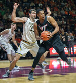 Virginia Tech forward Kerry Blackshear Jr. (24) looks to pass against Notre Dame forward John Mooney (33) during the second half of an NCAA college basketball game Tuesday, Jan. 1, 2019, in Blacksburg, Va. Virginia Tech won 81-66. (AP Photo/Don Petersen)
