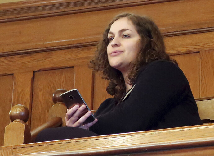 In this Wednesday, Feb. 13, 2019 photo, Rachel Sweet, a lobbyist for Planned Parenthood Great Plains, watches at the Kansas Senate debates a resolution condemning New York's new abortion law, at the Statehouse in Topeka, Kansas. She says,
