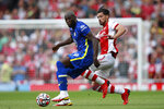 Chelsea's Romelu Lukaku, left, challenges for the ball with Arsenal's Pablo Mari during the English Premier League soccer match between Arsenal and Chelsea at the Emirates stadium in London, England, Sunday, Aug. 22, 2021. (AP Photo/Ian Walton)