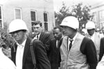FILE- In this Oct. 1, 1962, file photo, James Meredith, center, is escorted by federal marshals as he appears for his first day of class at the previously all-white University of Mississippi, in Oxford, Miss.