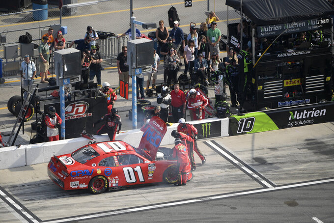 Stephen Leicht (01) has his car looked at by crew members on pit road during a NASCAR Xfinity Series auto race at Daytona International Speedway Saturday, Feb. 16, 2019, in Daytona Beach, Fla. (AP Photo/Phelan M. Ebenhack)